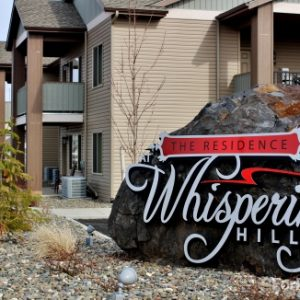The Residence at Whispering Hills sign